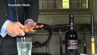 How to open a bottle of Port with a feather.