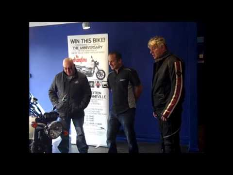 Stranglers Bonneville presented to winner by JJ Burnel