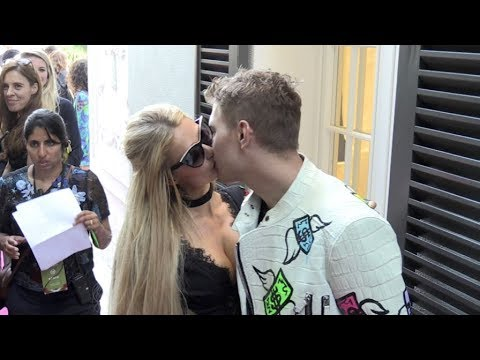 Paris Hilton and her boyfriend Chris Zylka share a tender kiss at the Philipp Plein Cruise Show 2018