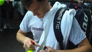 Jamie Murray signing autographs after practice Wimbledon 2011
