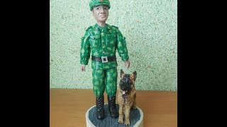 Пограничник с собакой из полимерной глины.