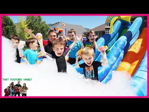 7 Second Squishy Challenge Down Giant Inflatable Water Slide!  That YouTub3 Family