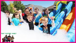 7 Second Squishy Challenge Down Giant Inflatable Water Slide! / That YouTub3 Family