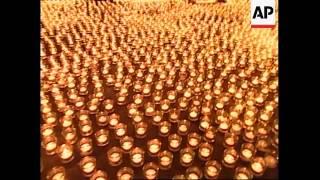 Children light candles for abused children