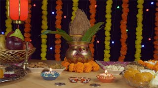 Pan shot of a beautifully decorated temple/mandir with copper Kalash and other Diwali items