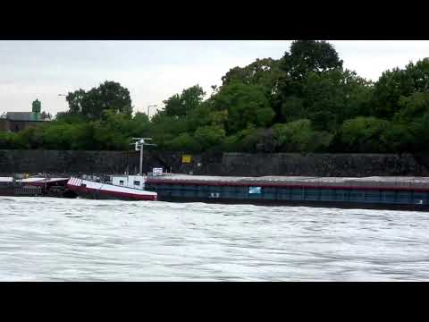 WORKING-IN-TANDEM. Massive Barges on the River Rhine, Germany - On a 'Uniworld River Cruise'