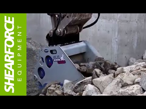 XC30 Xcentric Crusher Bucket Crushing Hard Rock in Vancouver, British Columbia, Canada