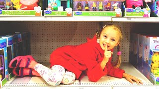 Polina with her mom pretend play hide and seek in the supermarket