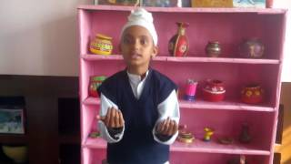 Husanpreet Kaur Student of Akal Academy Reeth Kheri reciting a poem