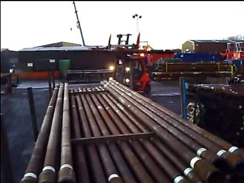 Foden loading offshore oil drilling pipe.