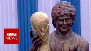 A wild-haired statue of footballing legend Maradona has been unveil...