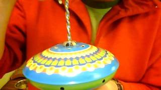 Spiral plunger spinning top mechanism