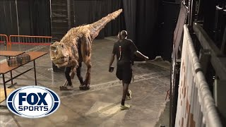 Halloween dinosaur shocks Suns' players