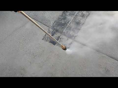Pressure Washing Driveway with Asphalt Tire Marks (818)964-1054