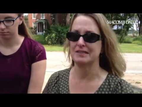 Linda Donan, with daughter Emma, describing funeral service for April Millsap at Catholic Church in