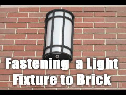 Fastening A Light To A Brick Wall With Sleeve Anchors
