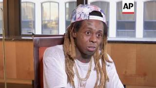Lil Wayne stands by his 'no such thing as racism' comment.