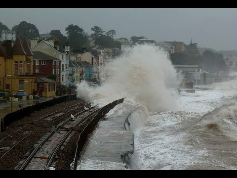 Dramatic scenes as huge waves batter Dawlish sea wall and station. Beach huts smashed.