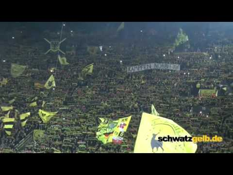 "Fans of Liverpool and Dortmund sing together """"You'll never walk alone""'"