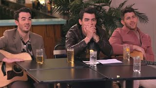 Watch the Jonas Brothers Get DRUNK and Sing NSFW Songs With Seth Meyers!