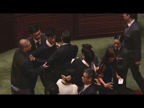 Brawl in parliament: Hong Kong lawmakers clash with rivals