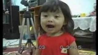 Cute Little Asian Girl Singing