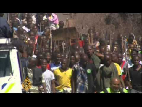 South Africa miners continue strike