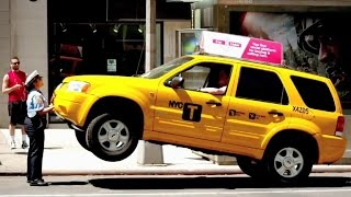 Watch a Parking Meter Attendant Lift a Taxi in Epic Prank!