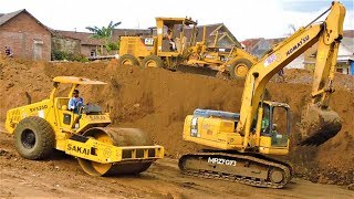 Excavator Dump Trucks Motor Grader Compactor Busy  Working On Toll Road Construction