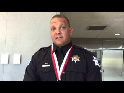 Officer Cary Weigant awarded lifesaving medal