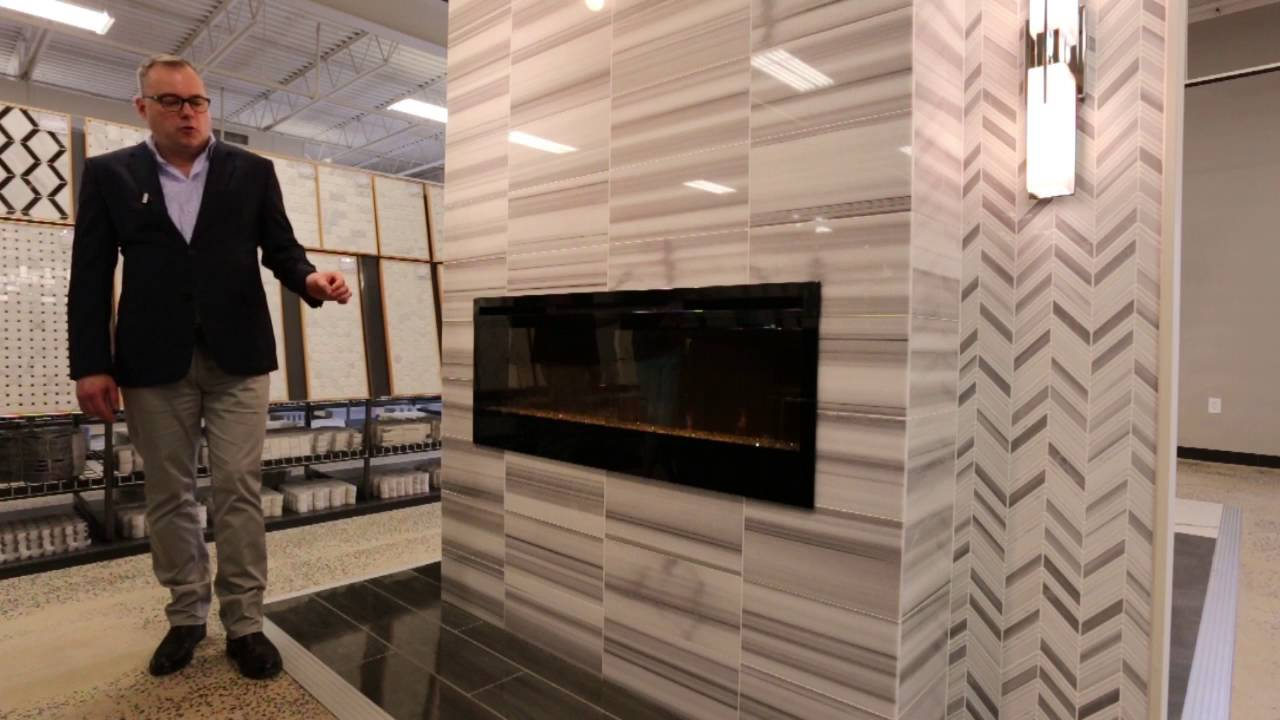 "The Tile Shop offers countless fireplace design ideas. A popular choice is the modern ""zebra stripe"" pattern of the Strato Bianco Turkish marble tile. To bal..."