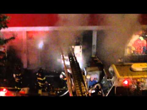 FDNY BATTLING 5 ALARM FIRE, WITH 200 FIREFIGHTERS, AT A SUPERMARKET IN HUNTS POINT, BRONX, NEW YORK.