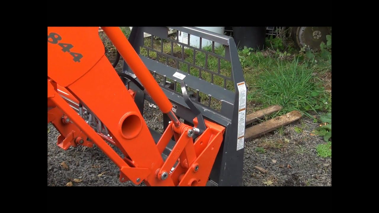 Demonstrating a Kubota quick attach loader  YouTube