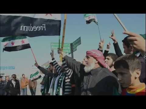 Syrians gather outside the Syrian embassy in Amman