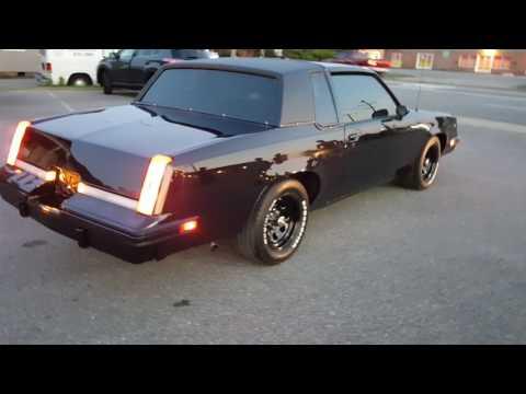 84 Oldsmobile Cutlass Black Cherry/ Johns Restoration