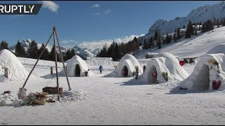 'God made snow, man made igloos': Ice village built by migrants brings tourists back to Italian Alps