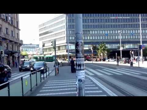 People running to catch the tram in helsinki, Finland
