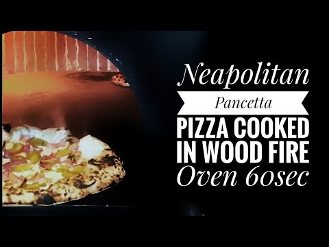 Pizza Napoletana cooked in wood fire oven