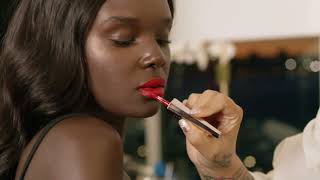 red lipstick being put on a model