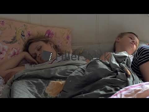 Sleeping mom, baby and elder son in bed