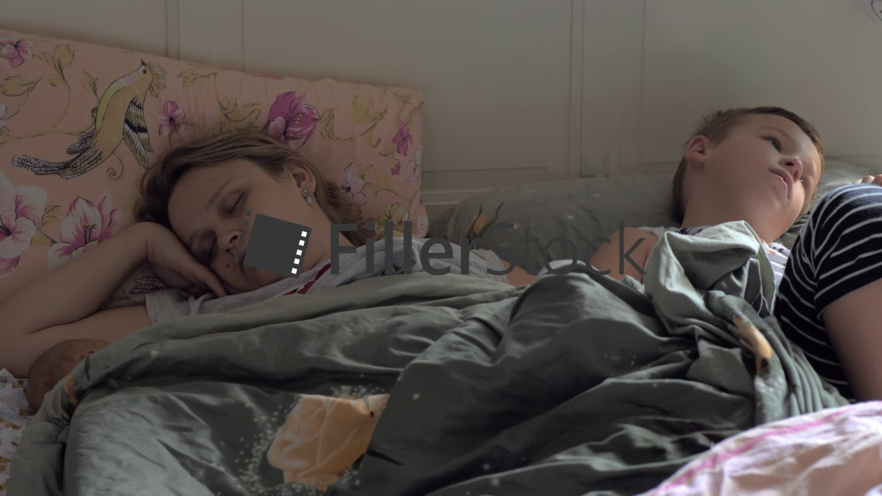 Sleeping Mom Baby And Elder Son In Bed