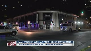 Man stuck in wall at Yard House Restaurant(Police think the man was secretly living in the rafters of the Yard House and fell through the ceiling., 2014-12-11T00:41:48.000Z)
