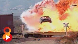 DAREDEVIL JUMPS CAR THROUGH SPEEDING FREIGHT TRAIN!