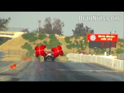 Drag car pulls chute to prevent crash