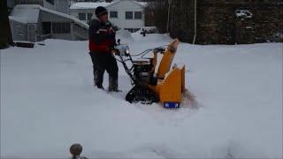 cub cadet 3x 30 trac snowblower playing in the yard