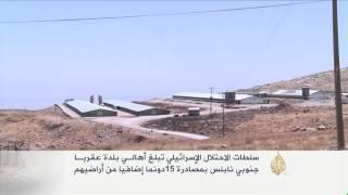 إسرائيل تبلغ أهالي عقربا بمصادرة 15دونما إضافيا