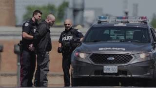 Dramatic video of police and Toronto Star reporters involved in a hostage negotiation. A hostage situation at a GTA massage parlour ended with police making arrest and no injuries.