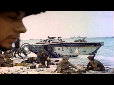 LVT and tank destroyer arrive on a beach Eniwetok Atoll, Marshall Islands during ...HD Stock Footage