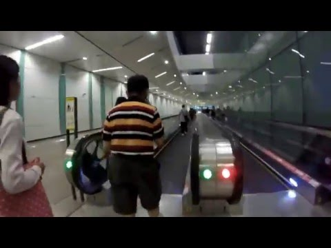 Taking the MRT train in Singapore