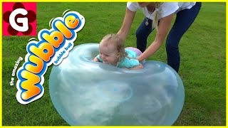 Kids playing outside with WUBBLE Bubble Ball. Family Fun time